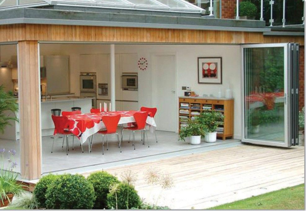 i like the bi-folds and how they open up the kitchen into the ...