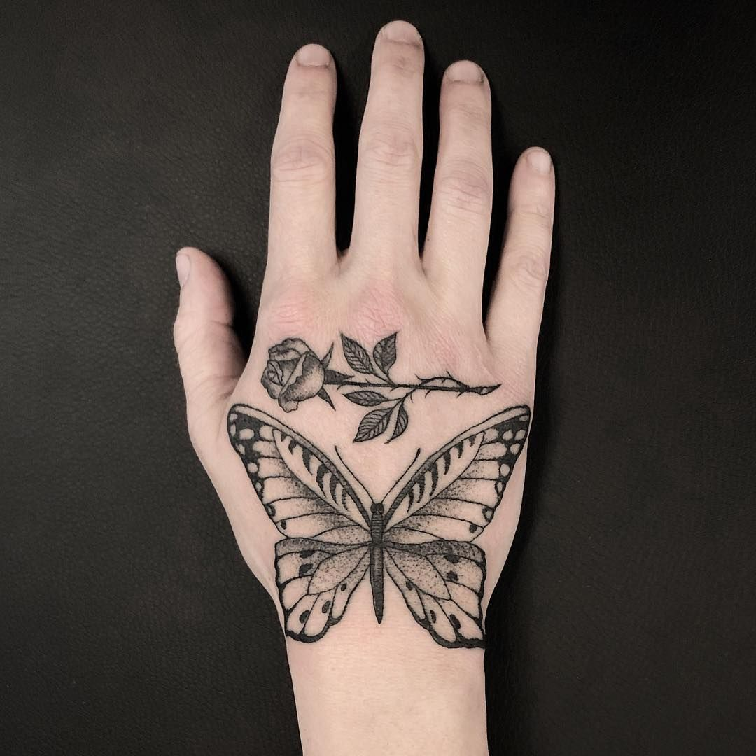 Butterfly And Rose Hand Tattoo Hand Tattoos Butterfly Hand Tattoo Hand And Finger Tattoos