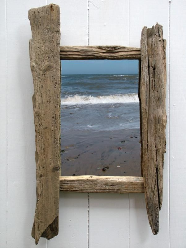 Constructed entirely of driftwood, this attractive mirror would make ...