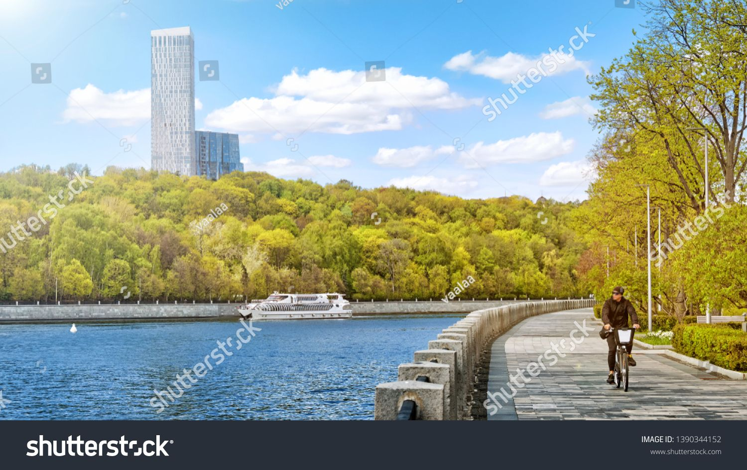 Moscow City Russia Park On Moskva River Embankment Street With Bike Lane Panorama View Of Modern Town Road Person Riding Bicycle On Sunn City Park Stock Photos