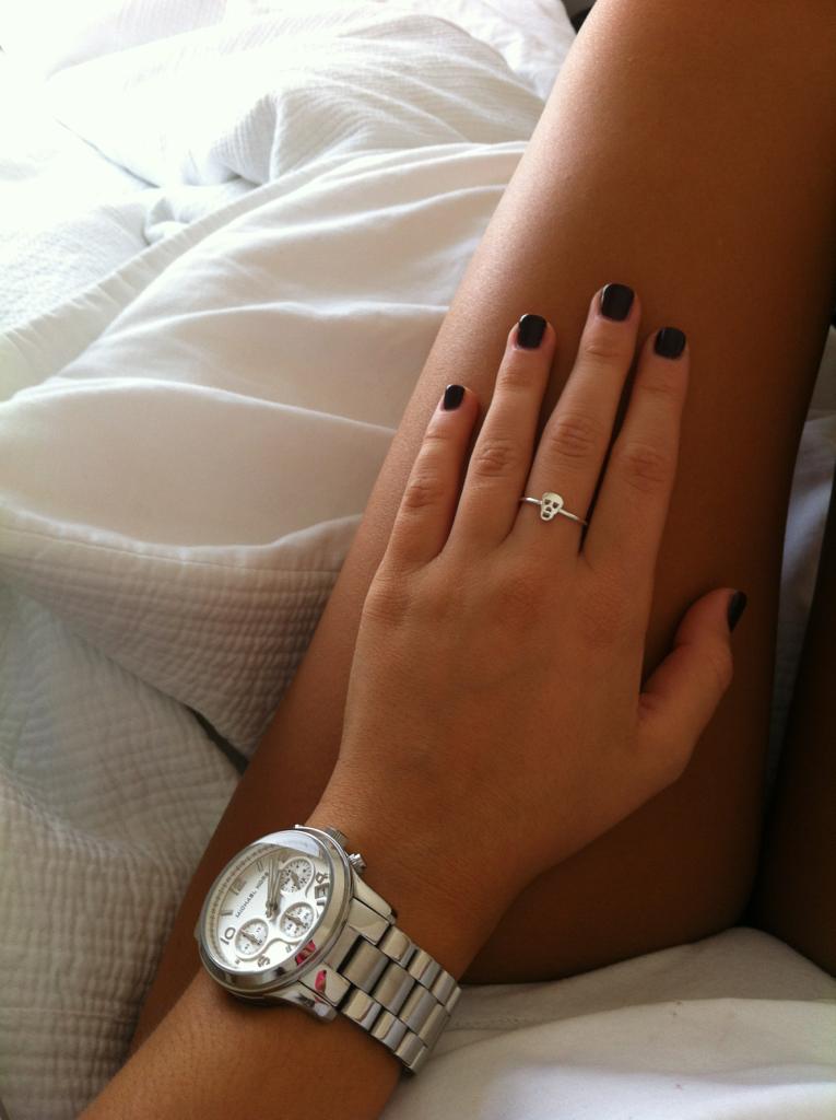 // Silver watch.