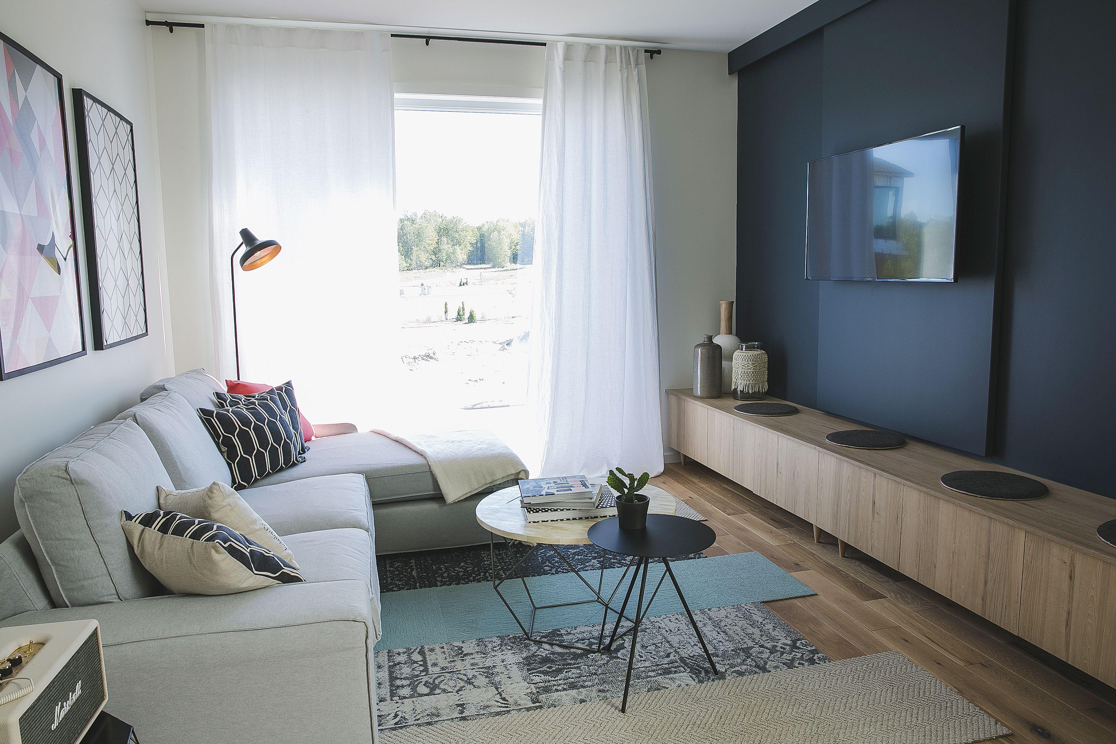 séjour scandinave mur télé tapis sectionnel