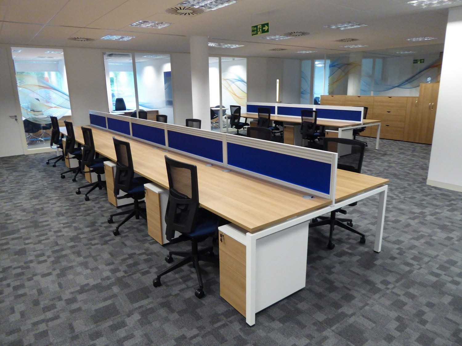 New open plan office space with blue desk dividers for Office design kent