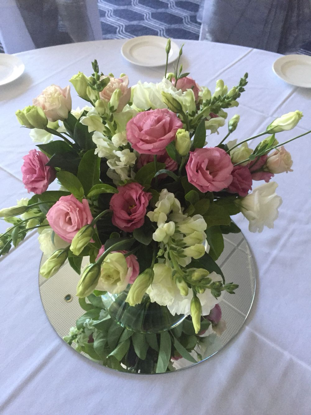 Fishbowl Filled With Fresh Elegant Blooms For A Wedding Centrepiece