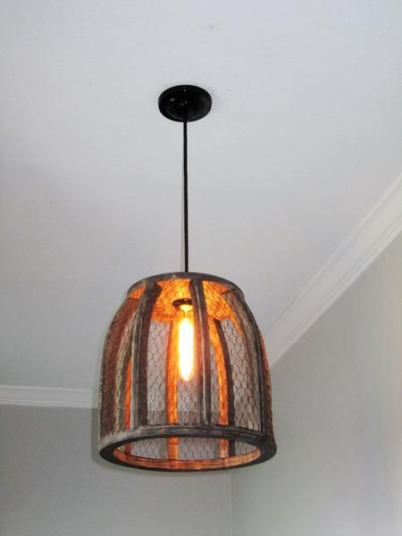 A mix of farmhouse, rustic, and vintage - this chicken wire pendant ...