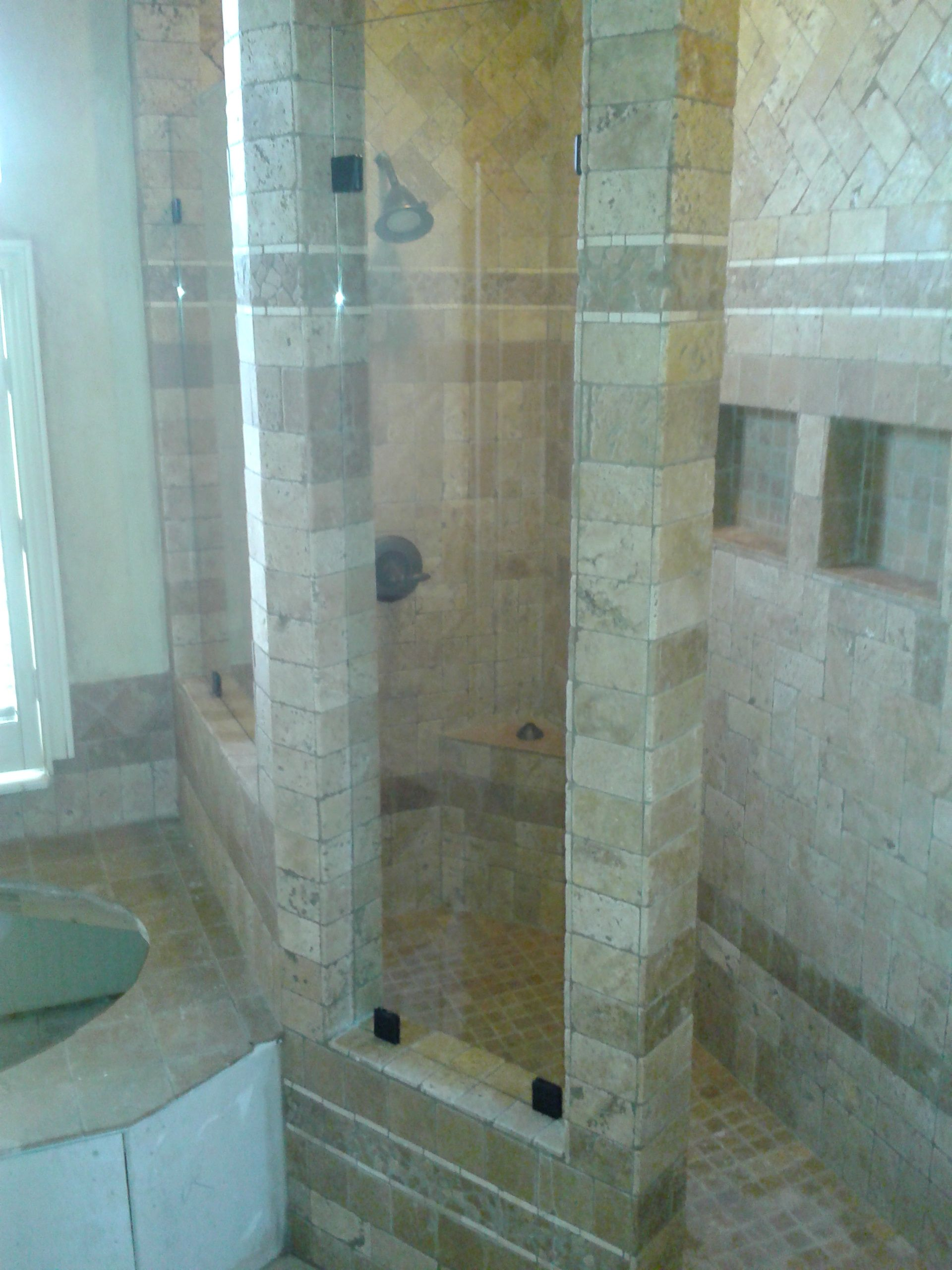 This is a walk in Shower with two opening in the tile that we put ...