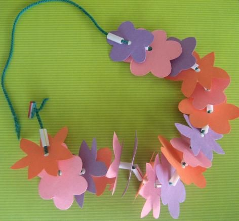 make a paper flower lei- a flower punch or two and maybe ...