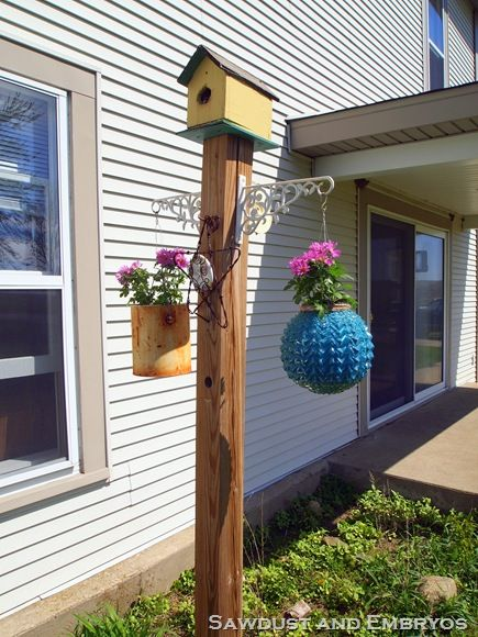 birdhouse, hanging flowers, temperature gauge, bird feed