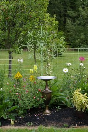 Jeanne's color-packed garden in Washington | Fine Gardening I have a very tall and unusual hammer brass lamp. It would make a fine bird bath base. Thinking about really doing this one.