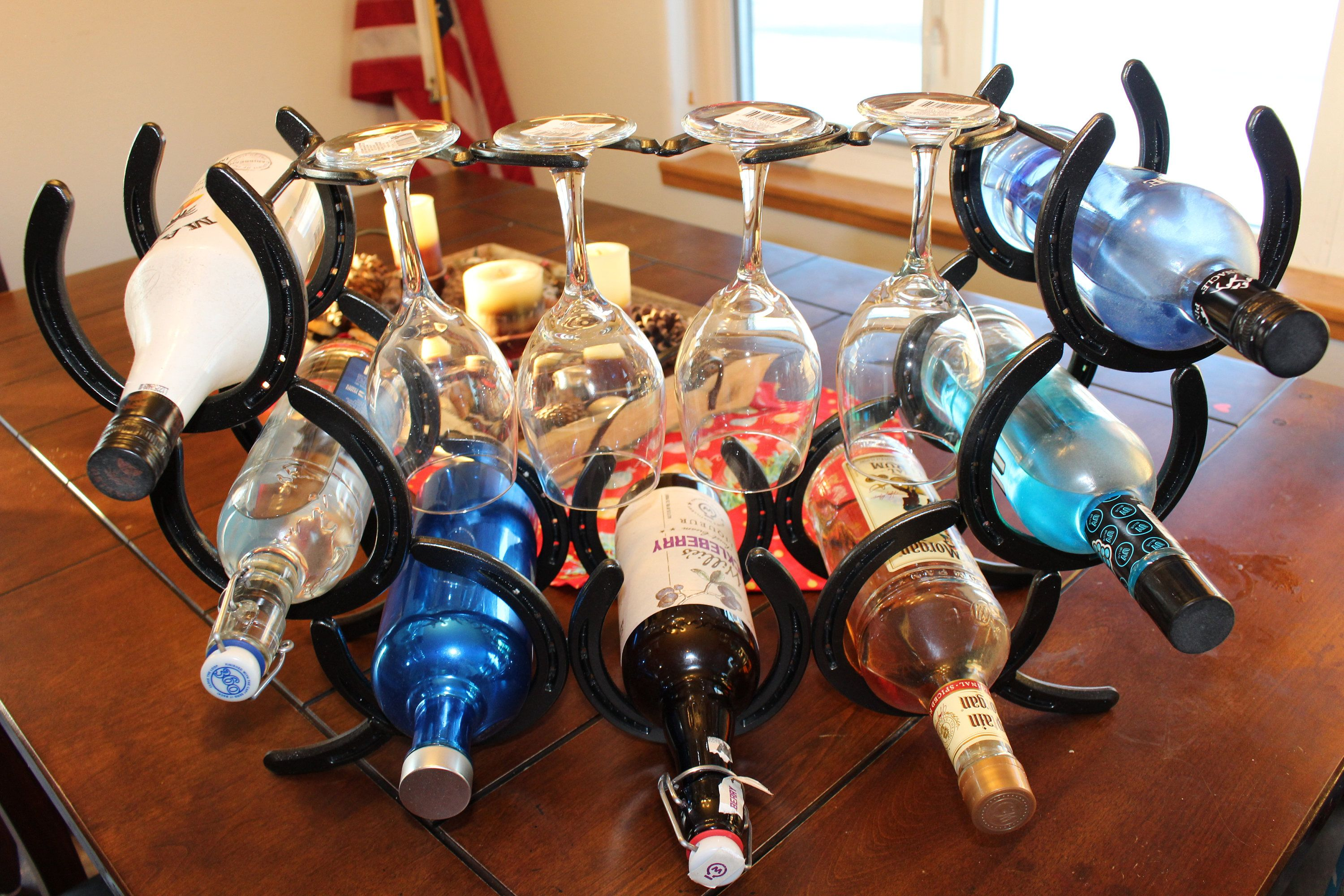 Horseshoe Wine rack holds four bottles and is made to go on side of cabinet.