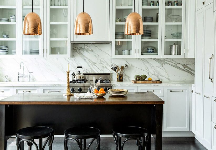Shiny Cooper | Copper pendants are a great option for any kind of room. here we have an excellent example: a dining area with light and earth colors and a couple of luxurious couple pendants falling from the ceilling. Magnificent!