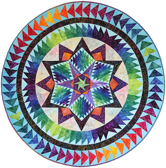 Cartwheel Constellation quilt - Gail Garber Designs 2009. I love the idea of circling with flying geese.