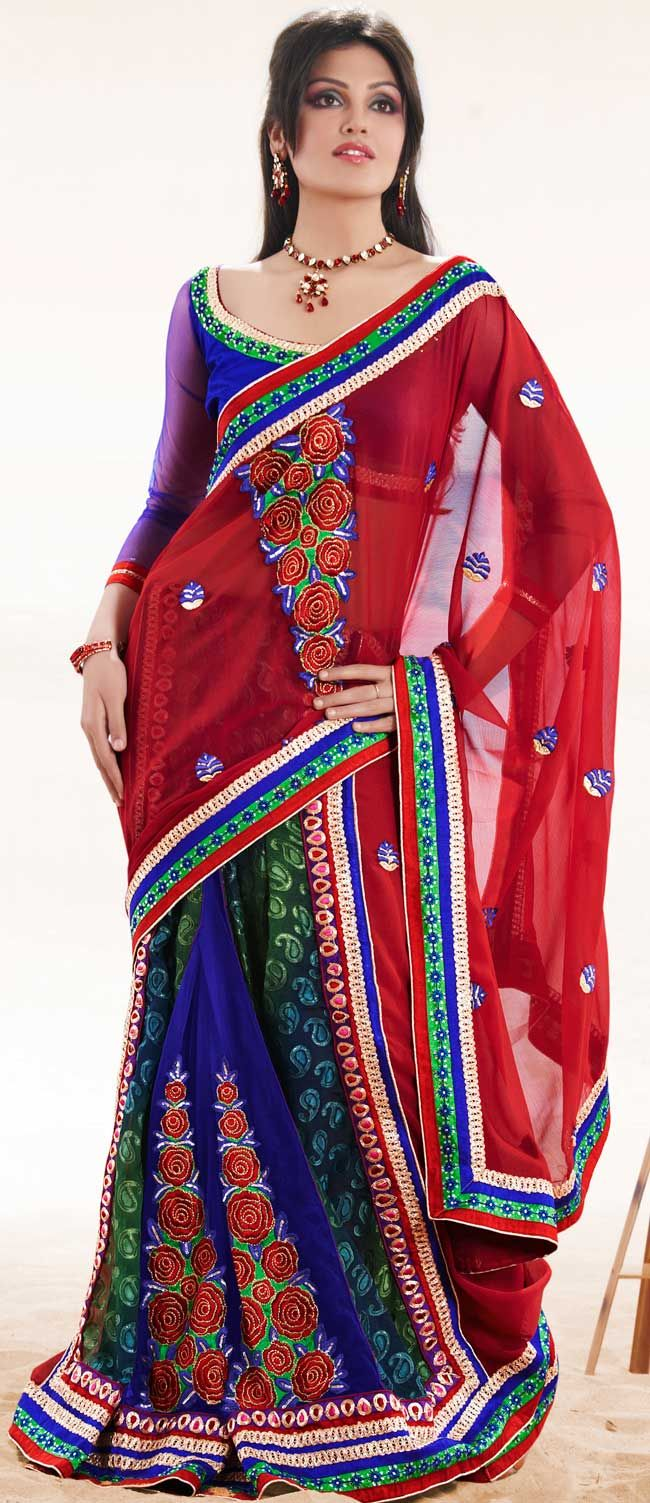 Ultimate collection of embroidered sarees with fabulous style.   This red, blue and green faux chiffon and net saree is nicely designed with embroidered patch work is done with resham, zari, sequins and lace work.   Beautiful embroidery work on saree make attractive to impress all.   This saree gives you a modern and different look in fabulous style.   Matching blue blouse is available.   Slight color variations are possible due to differing screen and photograph resolution.