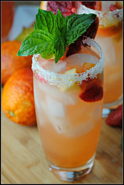 Blood Orange Sangria 6 blood oranges 1/2 cup sugar, for glass rimming 2 (750 ml) bottles Bulletin Place Pinot Grigio 1 cup club soda 1/2 cup brandy 12 oz strawberries, sliced 1 apple, chopped