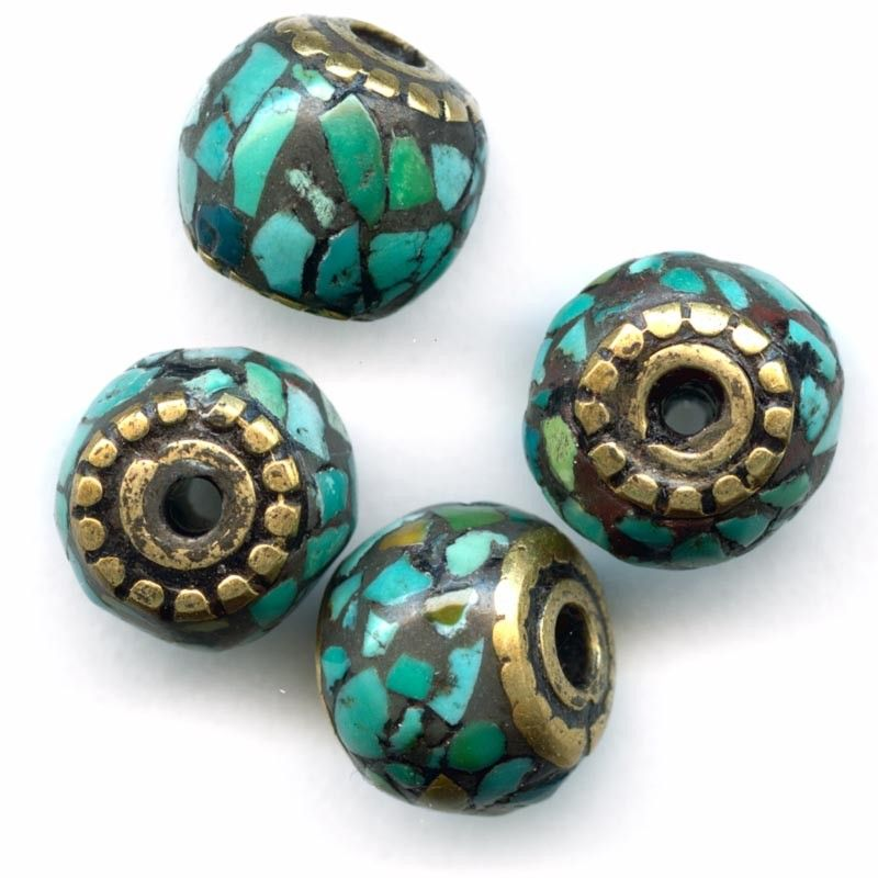 Hand made brass beads inlaid with turquoise, 10-11mm. Made in Nepal by Tibetan artisans.
