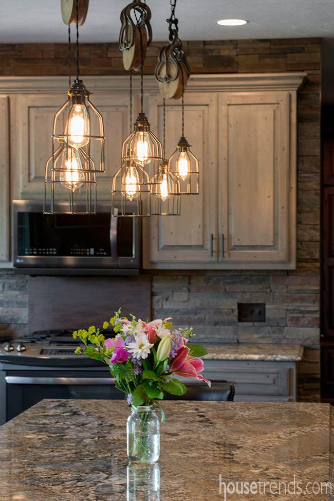 A Pulley System Furthers The Rustic Design Of The Lights Dangling Over This Kitchen Island Rustic Lighting Antique Kitchen Island Rustic House Plans