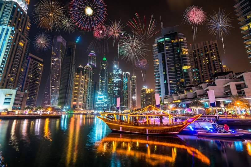 Firework display at Dubai Marina at night New year's eve