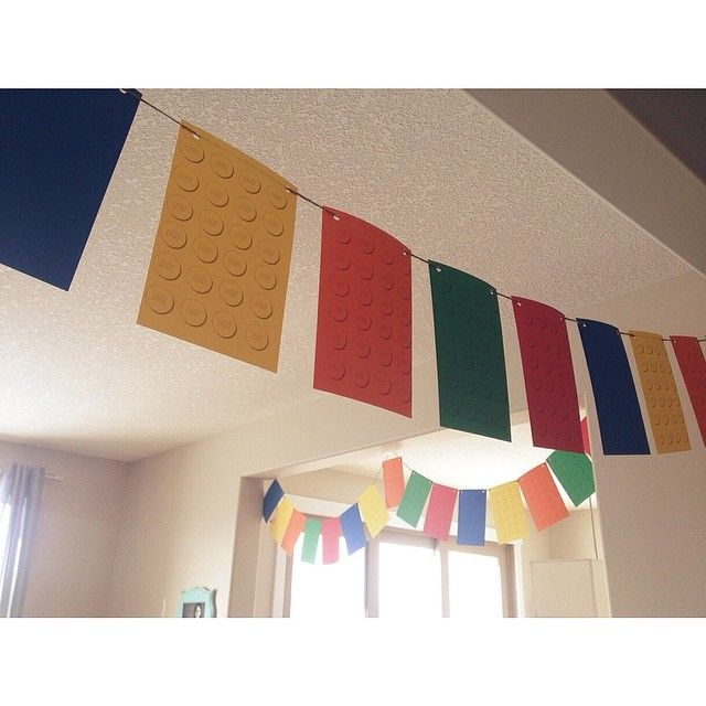 Lego birthday banner. Print at home on coloured paper, punch holes, and string up. Super easy!