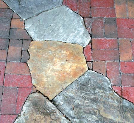 The above patio is created with hooper s creek quarried for Mixing brick and stone