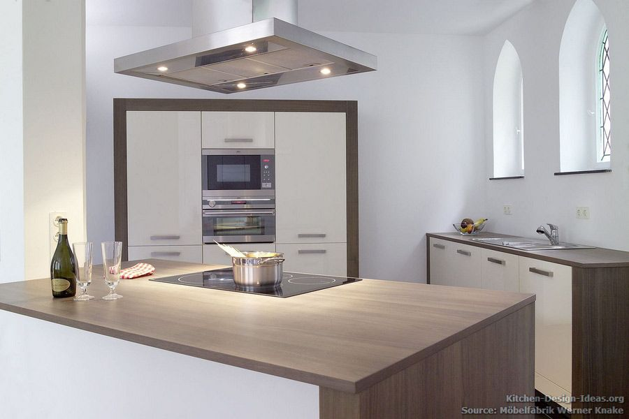 Minimalist Kitchen With Cream Cabinets And Walnut Wood Countertops Complements The Gothic Arches Of Th Modern Kitchen Minimalist Kitchen Kitchen Cabinet Design