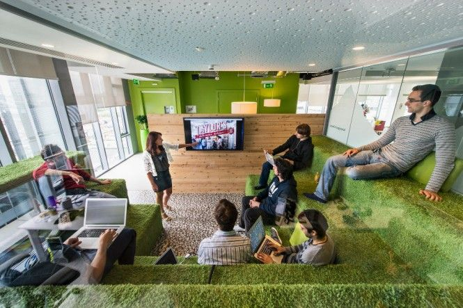 This nature-themed space features grassy grandstand seating, dewdrops on the ceiling and woodsy accents | Google | Modern Office | Shared WorkSpace