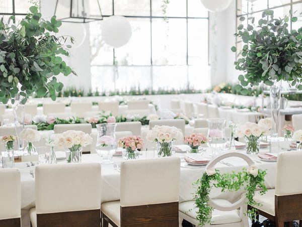17 Valentine's Inspired Wedding Ideas | You don't need to go all out with reds and pinks when it comes to V-Day decor (although you definitely can if you want to). An all-white reception with pops of blush is the mod way to keep the spirit throughout your event design.