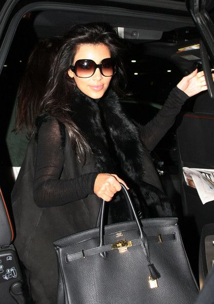 ceda4a190ecf Kim K is dressed to kill in all black. She is wearing a fading lens sunglass  that makes her look so good. Brand  Balenciaga