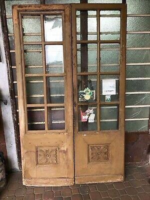 Ancient shop door in rusticated solid wood glazed …