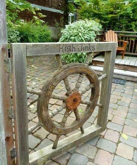 Gate Made From Old Boat Wheel Nautical Landscaping Beach Cottage Style Beach Theme Garden