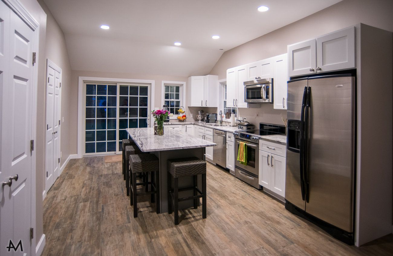 "Our kitchen Pretoria White Granite, Tile ""Wood"" floors"