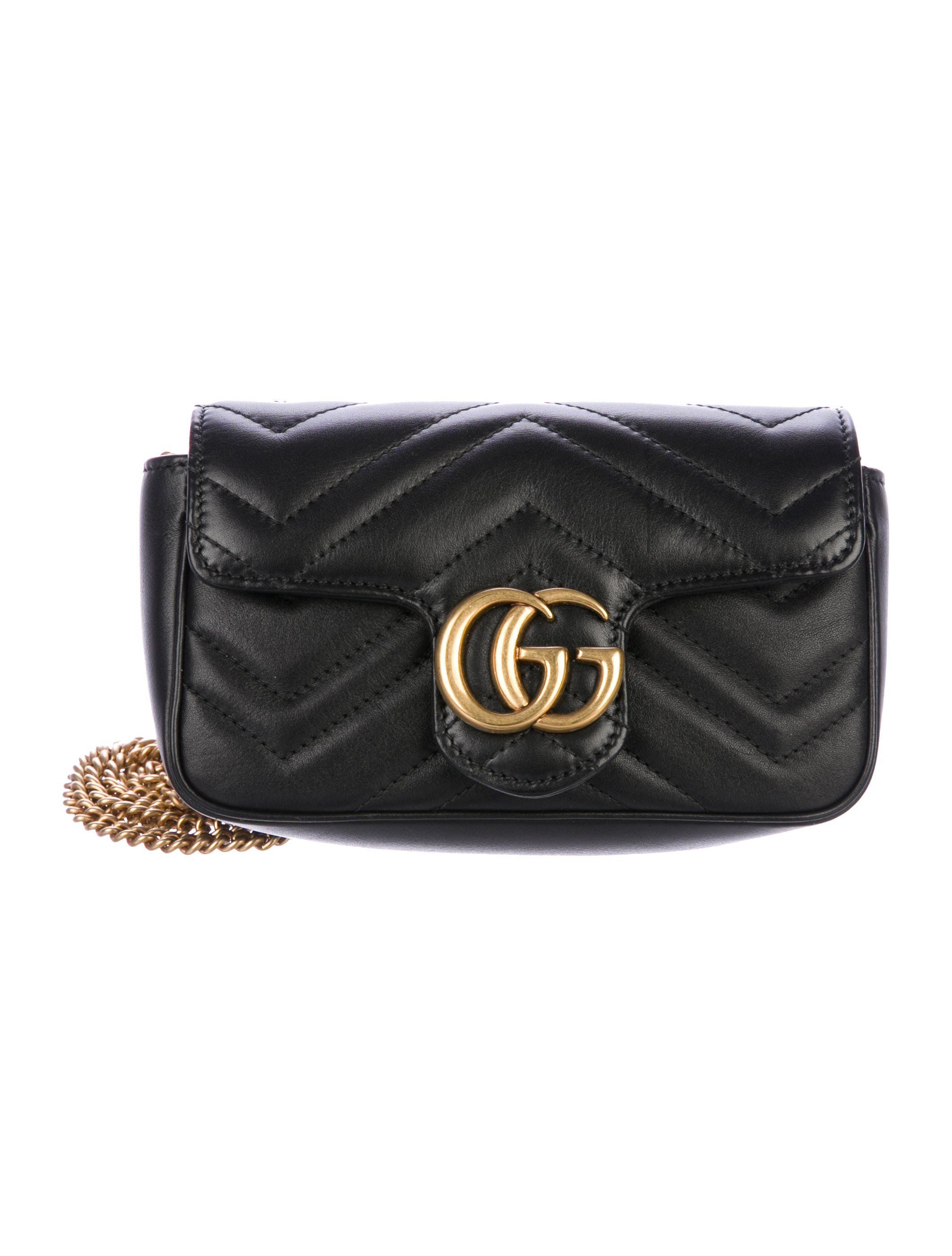 f6d3a3f6bd6e From the Current Collection. Black matelassé chevron leather Gucci Marmont  super mini bag with brass