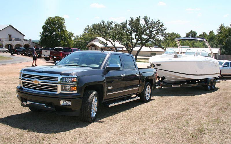 2014 Chevrolet black Silverado towing a boat Boat, Used