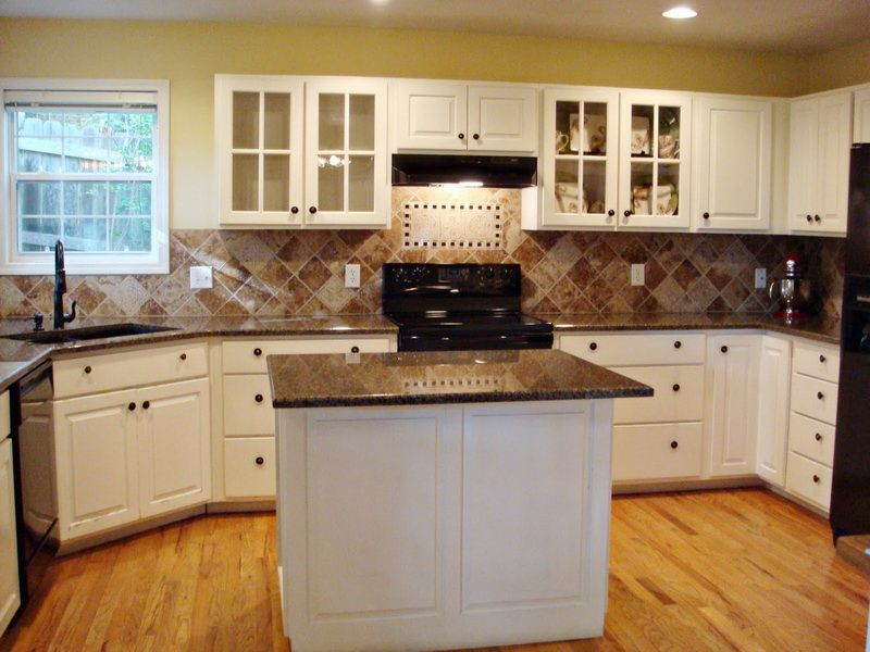 Kitchen Tropical Brown Granite Countertops With White Cabinet