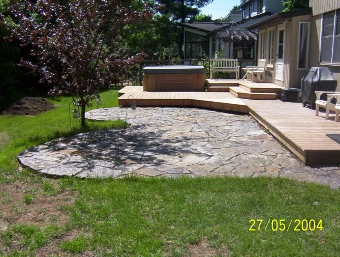 Flagstone Or Other Stone/concrete Patios Are A Great Alternative To A Deck  In Bungalows Or Other Ground Level Living Spaces. Or Do What Theyu0027ve Done  Here ...