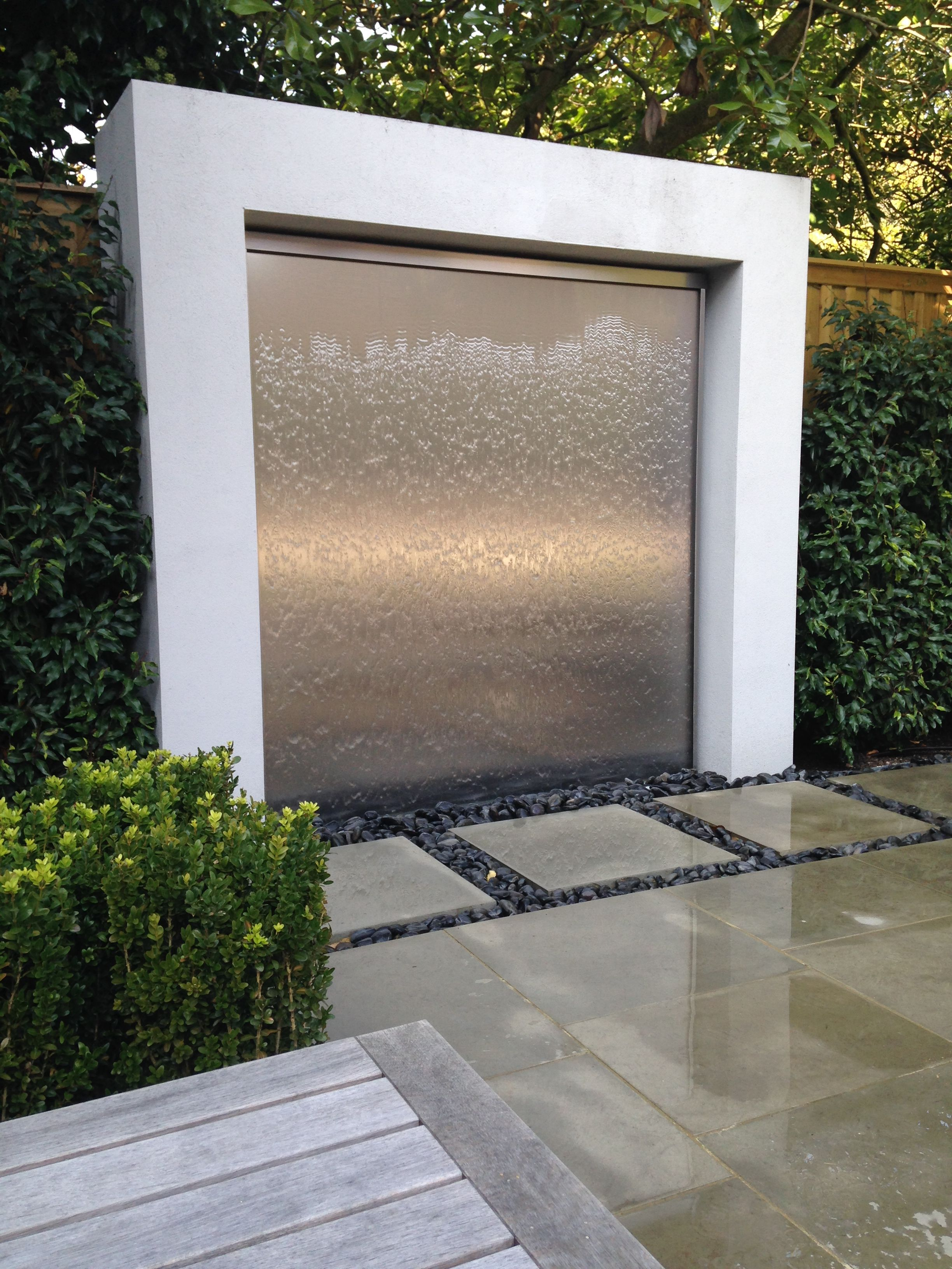 A shimmering rolling wave of water being created down a - Wasserwand outdoor ...