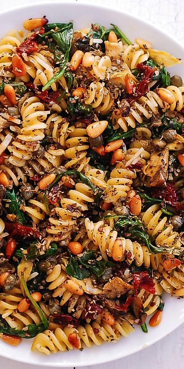 Pasta with Spinach, Artichokes, Sun-Dried Tomatoes, Capers, Garlic, and Pine Nuts Italian Pasta wit