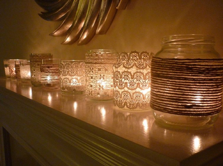 Various jars and old lace/twine/fabric + tealights = wonderful candlelight.