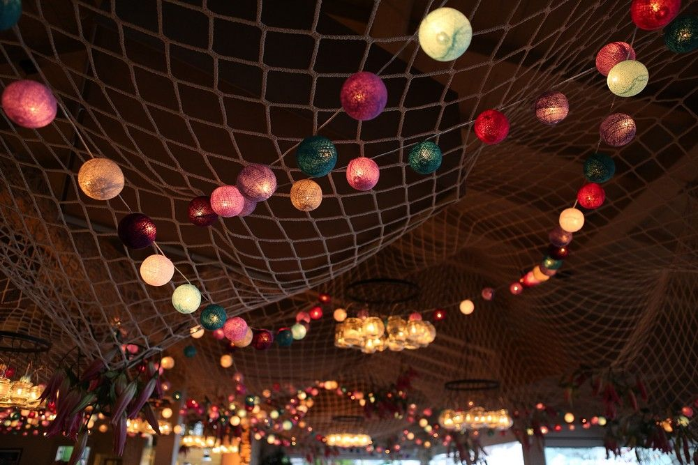 c78b84fbc6fa7 Ceiling decoration with fishing net and coloured light balls ...
