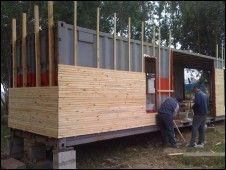 in the box container wood clad facade covering the. Black Bedroom Furniture Sets. Home Design Ideas
