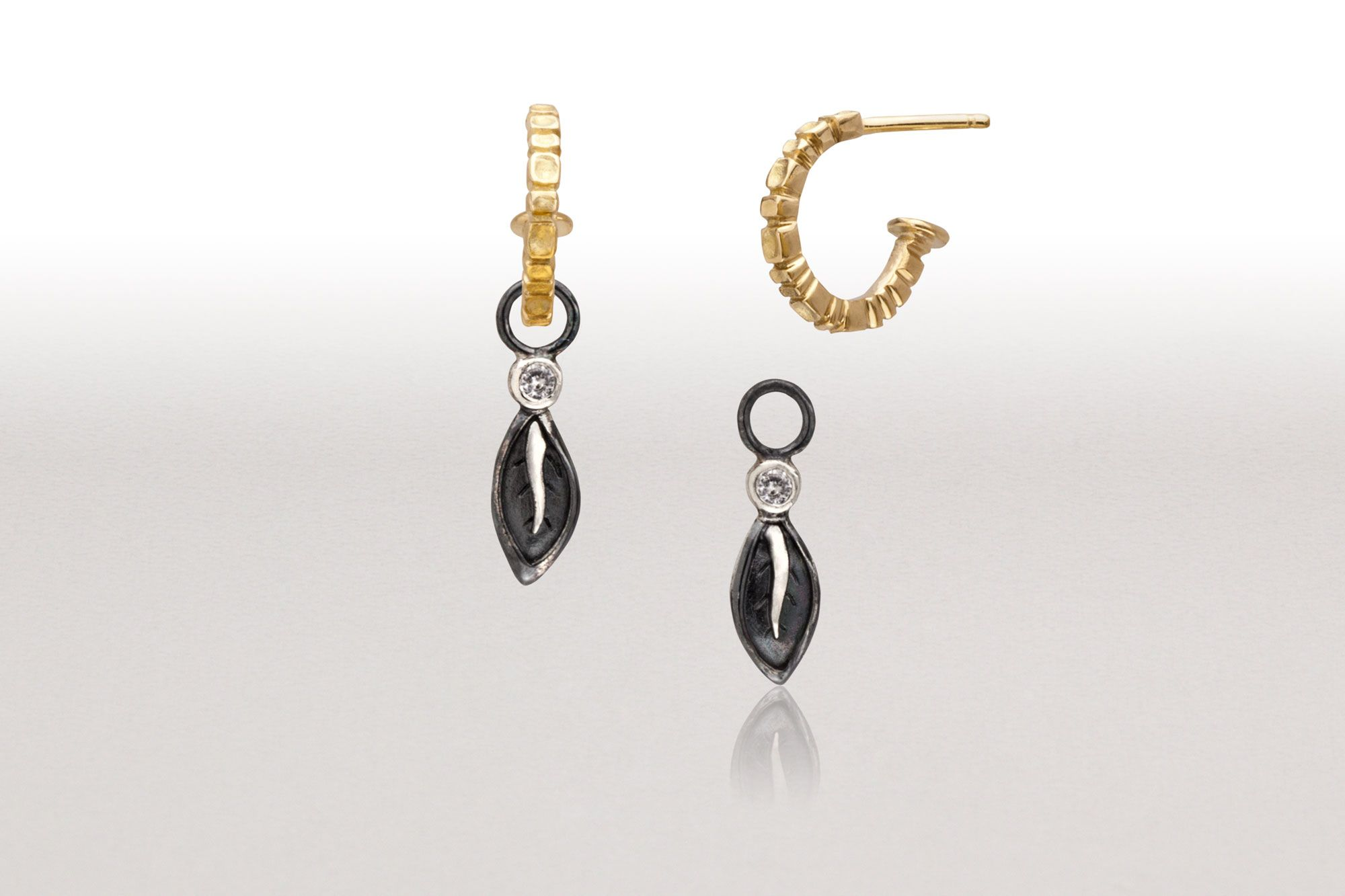 conni mainne combination of 18k gold demi hoop earrings and