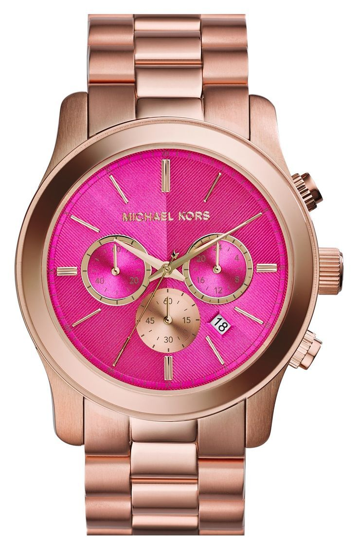 632a3a30ada1 Rose gold and pink Michael Kors watch.