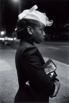 Such a deeply classy, elegant look. Love the netting on the hat. (Harlem 1940's by Martin Barrat.).