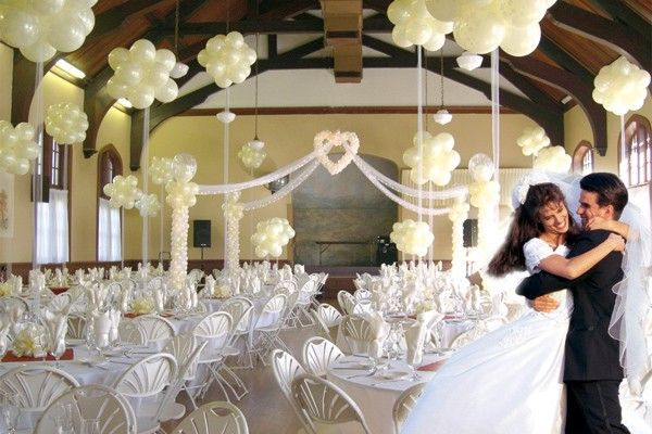 At an evening wedding the reception hall with these balloons and
