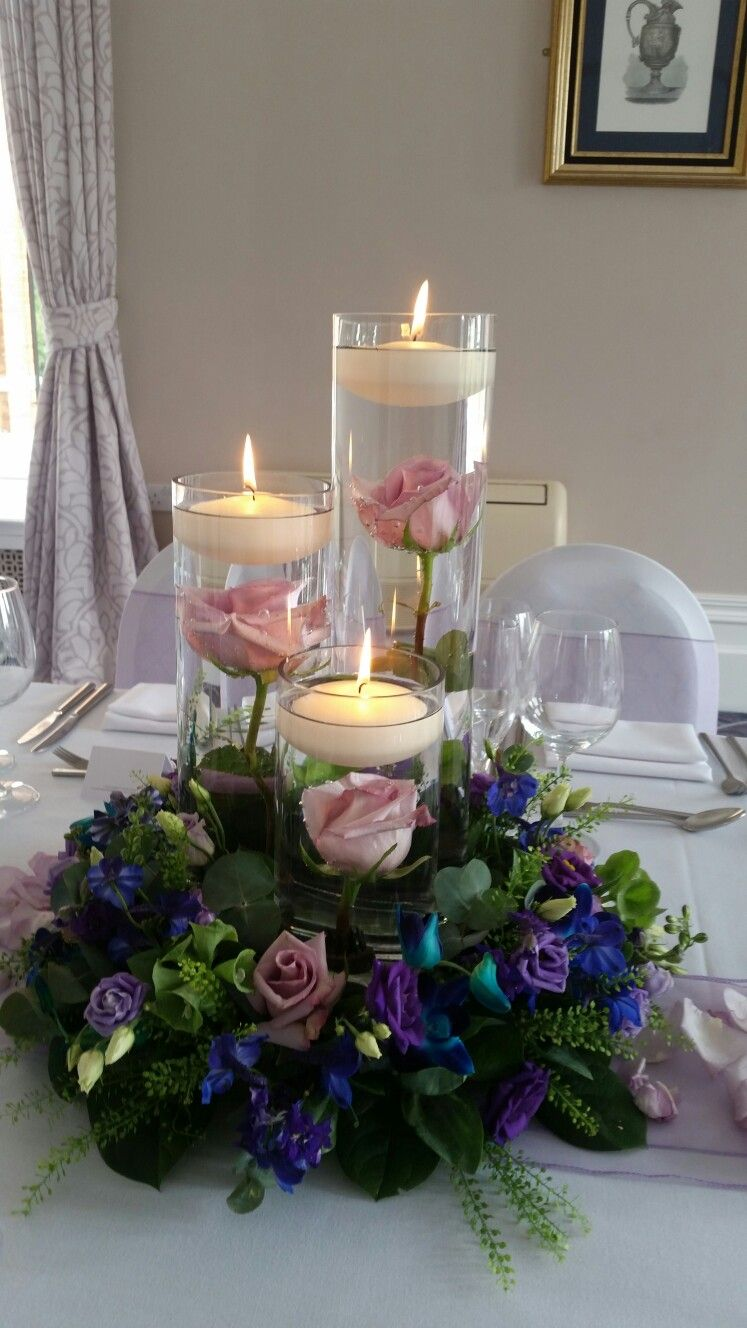 submerged roses with flowers surrounding and floating candles rh pinterest com
