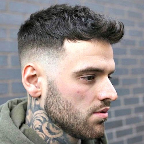 High Taper Fade With Textured Crop And Beard Mid Fade Haircut Mens Haircuts Fade Haircuts For Men