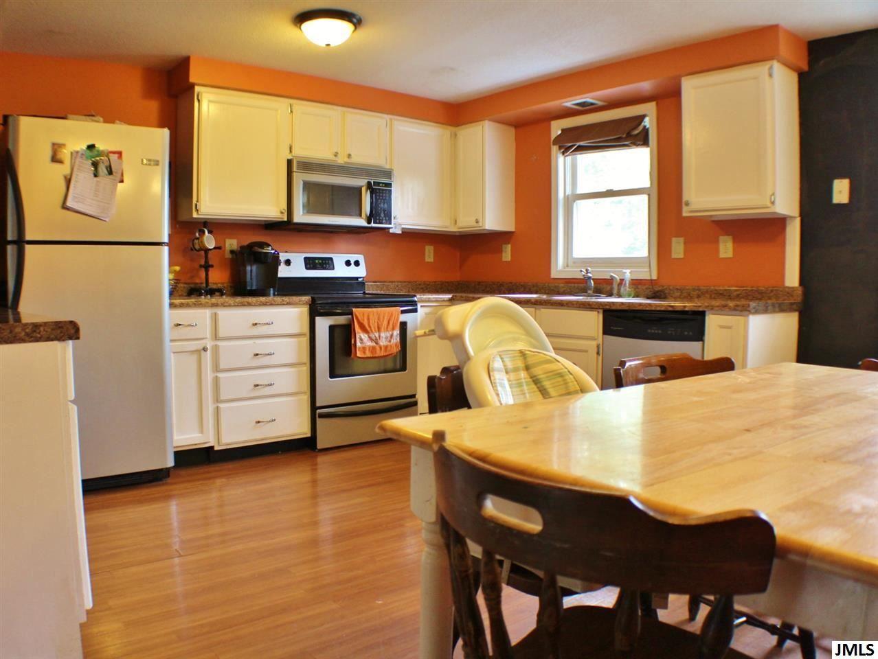 Jackson Michigan Real Estate Orange Kitchen Walls Kitchen Design Stylish Kitchen