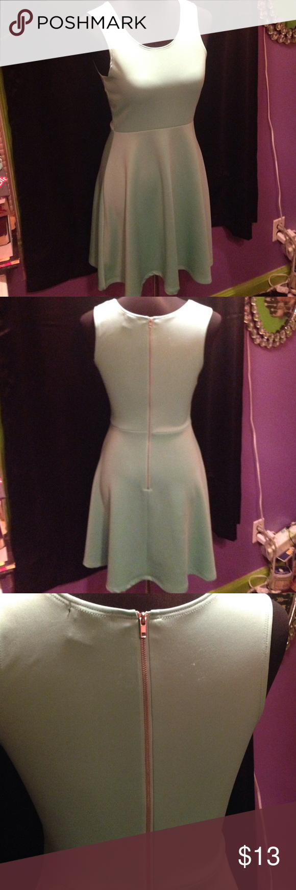 NWOT Seafoam Green Zippered Back Dress I bought this from Rue21 and washed it but I never wore it. It's just been hanging in my closet. It has a couple pills from being washed but other than that it's in perfect condition! It's a pretty Seafoam green color but I couldn't get the exact color to show but the last pic is closest to the true color. It also has a metal zipper down the back. Rue 21 Dresses