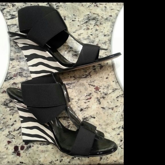 """Sale! Sexy  Manolo Blahnik Wedge! Authentic Manolo Blahnik 4""""  zebra wedge purchased from Neiman Marcus last year has stretch fabric straps & patent leather with  cloth wedge very comfortable & hate to part with them but has sat in the closet All year! :-( (worn once) Manolo Blahnik Shoes Wedges"""