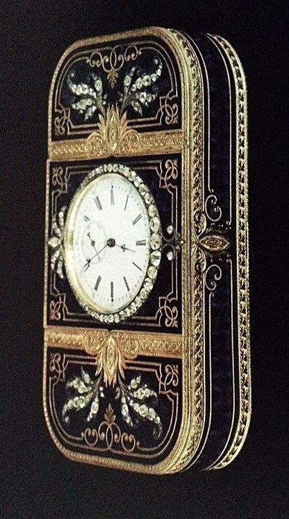 Faberge engraved gold box with blue enamel and diamonds and a clock set into the lid. #antique #vintage #box