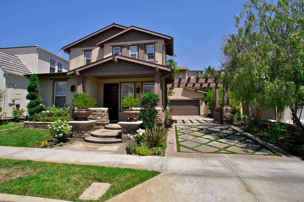 Craftsman style landscape and facade mid tone latte color for Mission style homes for sale